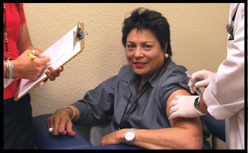 Photo image of Margo Kerrigan getting her flu shot