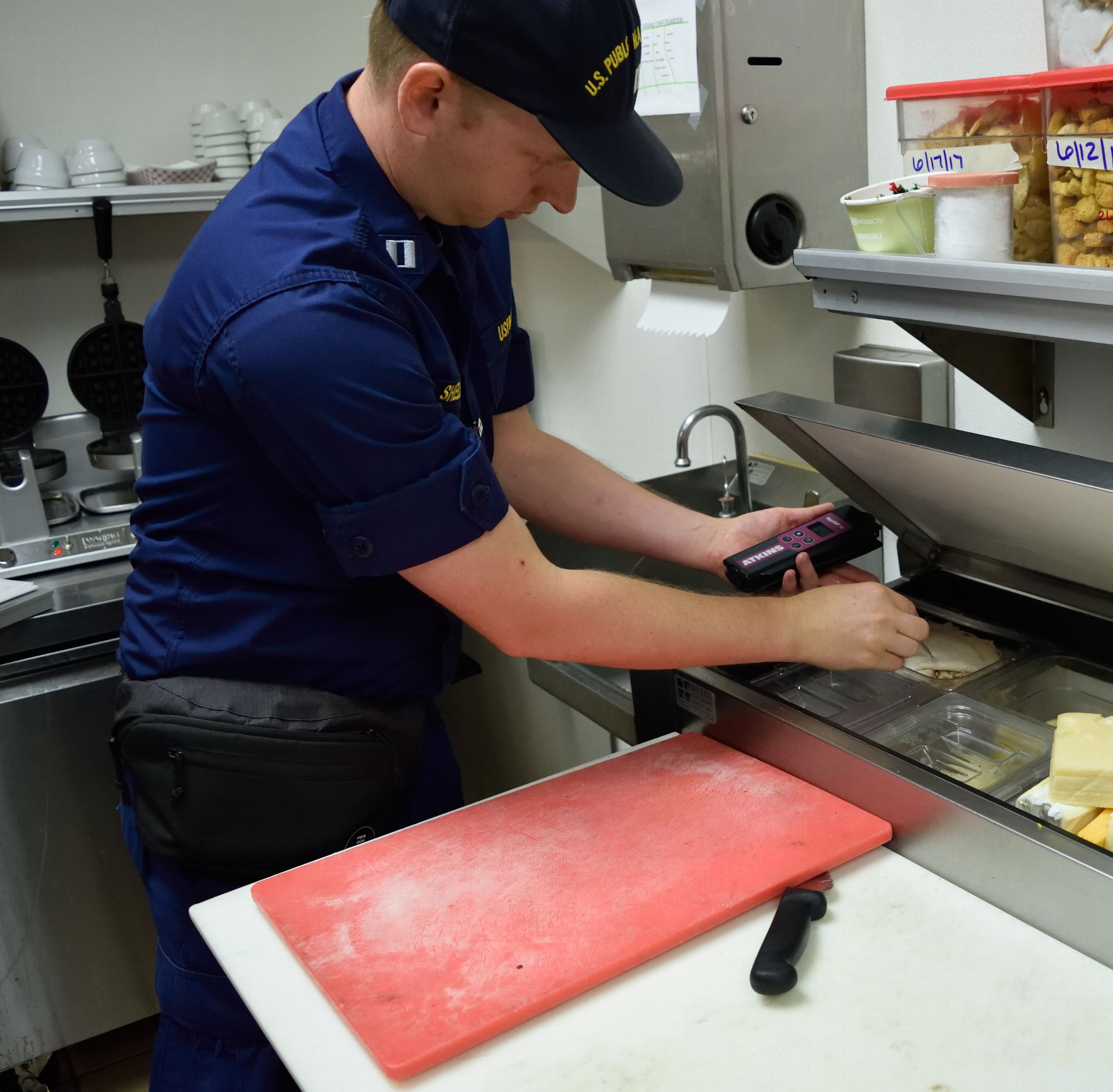 PHS Officer testing food temperatures