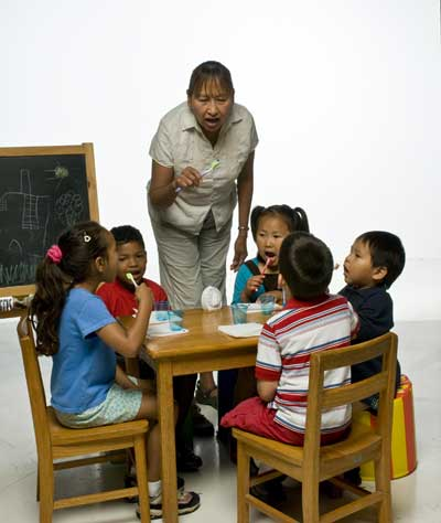 Teacher with students in a Head Start setting.