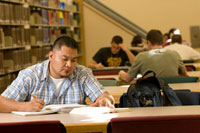 Male Student Studies at Library