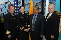 Left to Right: Dr. Charles Grim, LCDR Lori Moore, Jim Toya, and Robert McSwain