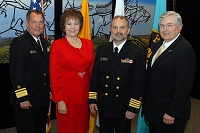 Left to Right: Dr. Charles Grim, Mary Lou Stanton, CAPT Marty Smith, and Robert McSwain