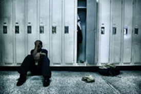 boy sitting at the lockers