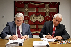 Indian Health Service Principal Deputy Director Robert G. McSwain and Cherokee Nation Principal Chief Bill John Baker sign a Joint Venture Construction Program agreement at the IHS Headquarters in Rockville, Maryland, Feb. 24, 2016.