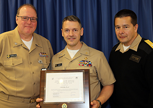 Presentation of DEHS Environmental Health Specialist of 2016 (L-R: CAPT David McMahon, CDR Mike Reed and RADM Chris Buchanan.)
