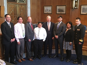 RADM Chris Buchanan with witnesses and Members of Congress after the U.S. Senate Committee on Indian Affairs hearing.