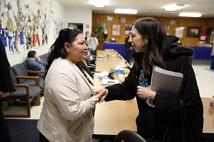 Ms. Smith greets Catherine Wooden Knife, Rosebud Sioux Tribal Council Member and Tribal Health Board Vice Chair