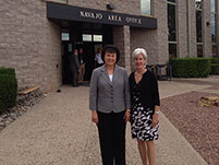 Thumbnail - clicking will open full size image - Secretary Sebelius and Dr. Roubideaux in front of the Navajo Area Office