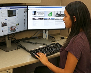 Tamia Weahkee, a high school student and IHS Pathways intern, reviews Generation Indigenous social media posts.