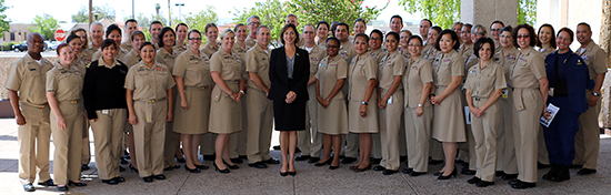 Acting Assistant Secretary for Health, Karen DeSalvo, MD (center), stands with PIMC Commissioned Corps officers.