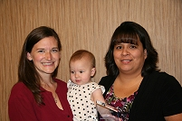 Thumbnail - clicking will open full size image - Kristen Krane and her child, with Supervisory Clinical Nurse Charlene Ramirez, Obstetrics/Inpatient Ward at Blackfeet Clinical Hospital
