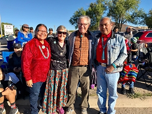 Dr. Chris Percy (second from right) and his wife Carol (second from left) take time to take a photo with Northern Navajo Nation Fair parade attendees.