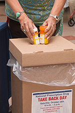 A federal employee disposes of unwanted prescription drugs.