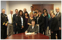 Thumbnail - clicking will open full size image - Dr. Roubideaux signing LMRC Charter