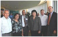 Thumbnail - clicking will open full size image - Dr. Mathuram Santosham is to the left of Dr. Roubideaux and accompanied by his wife and colleagues