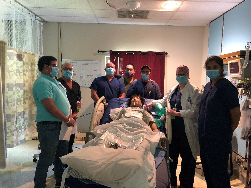 Claremore staff and members of the CCRT conduct training with a patient simulation mannequin at the Claremore Indian Health Hospital.