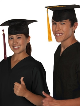 Two students in graduation gown