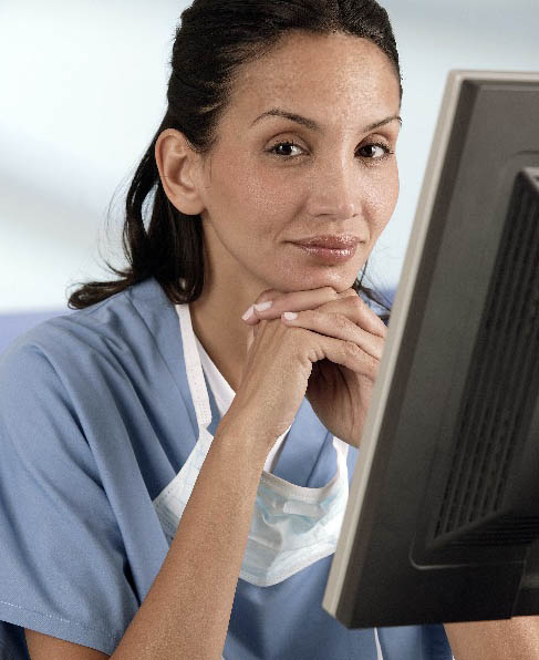 A doctor sitting in front of a monitor